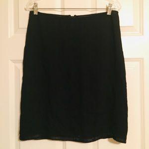 Black DKNY silk skirt w/ bead design around skirt